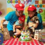 Blowing candles together