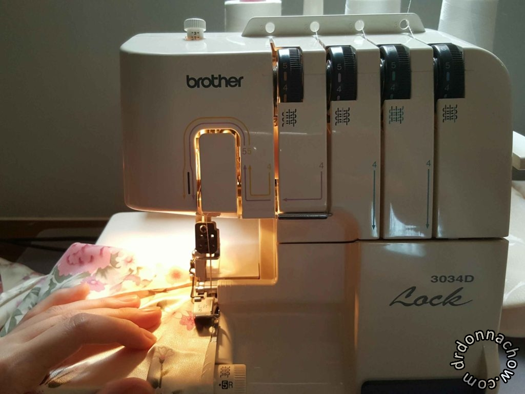 A serger is used to sew the rolled hem along the sides