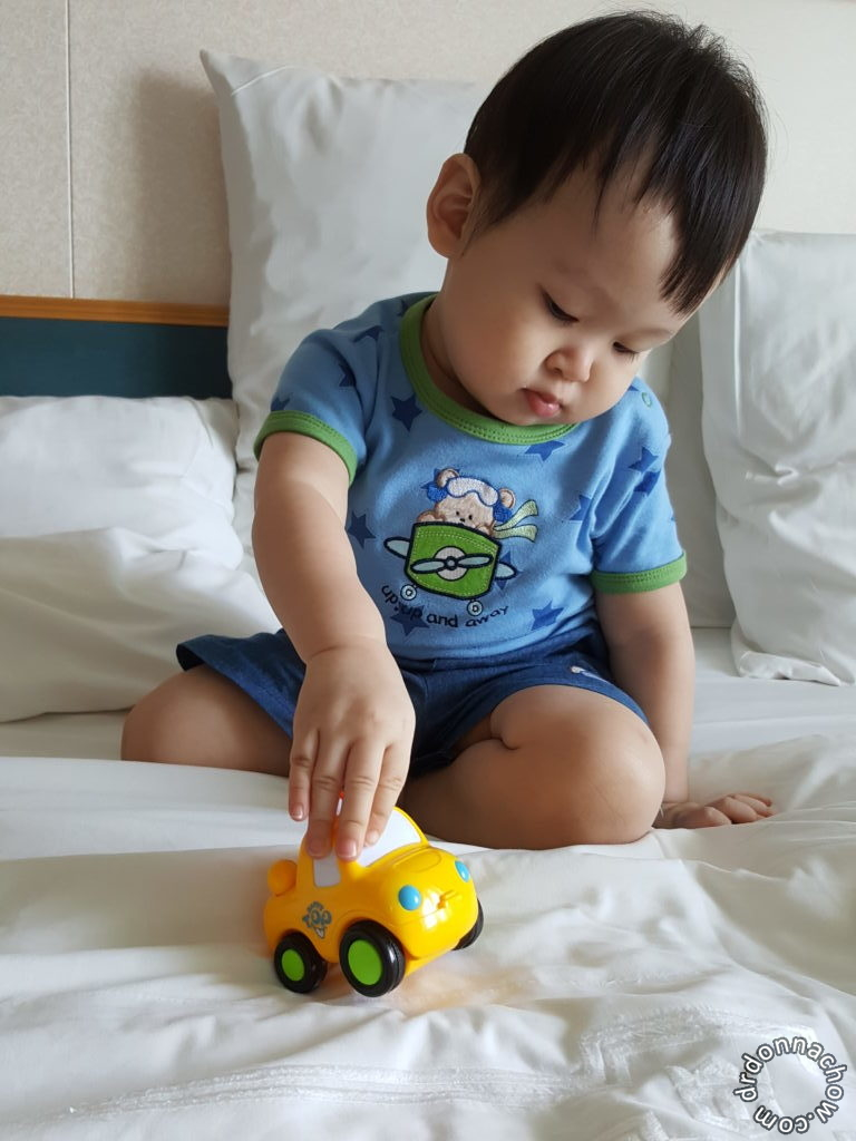 He likes his toy car so much we have to pack it along