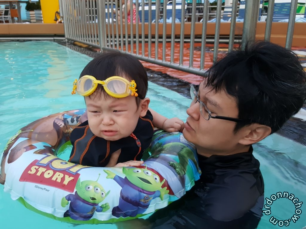A grouchy baby in water
