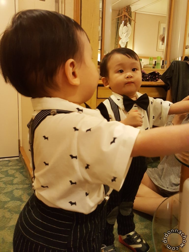 Looking at his own reflections in the mirror