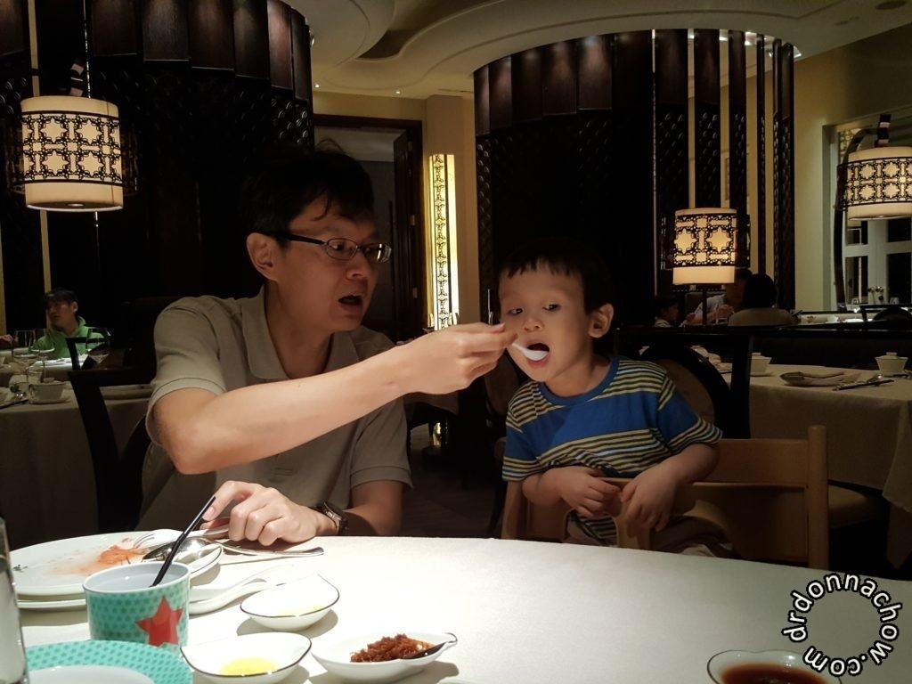 Daddy feeding him food