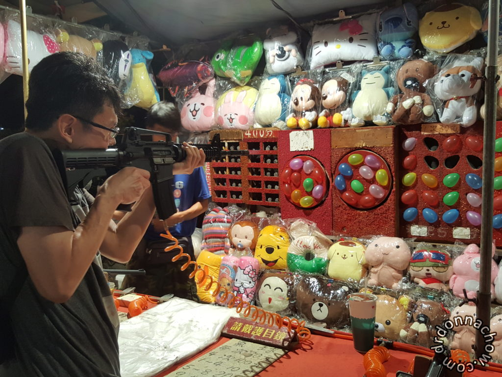 Shooting balloons at Flower Night Market