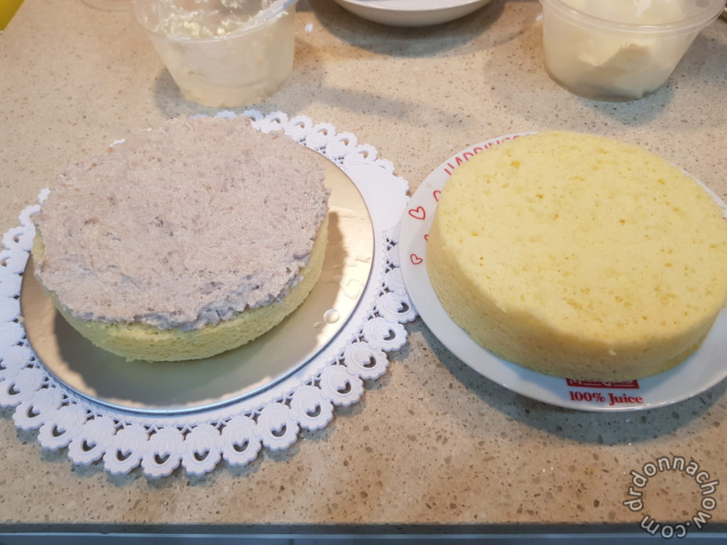 The cake sliced into two halves and sandwiched with yam