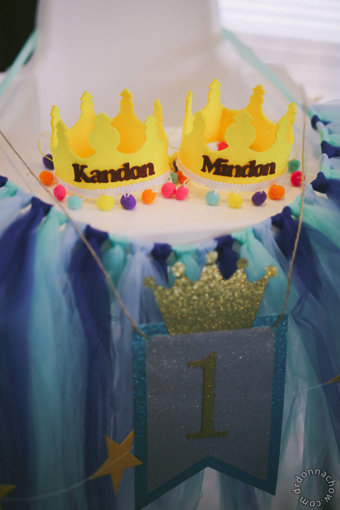 Customized party hats on a high chair with tutu skirting