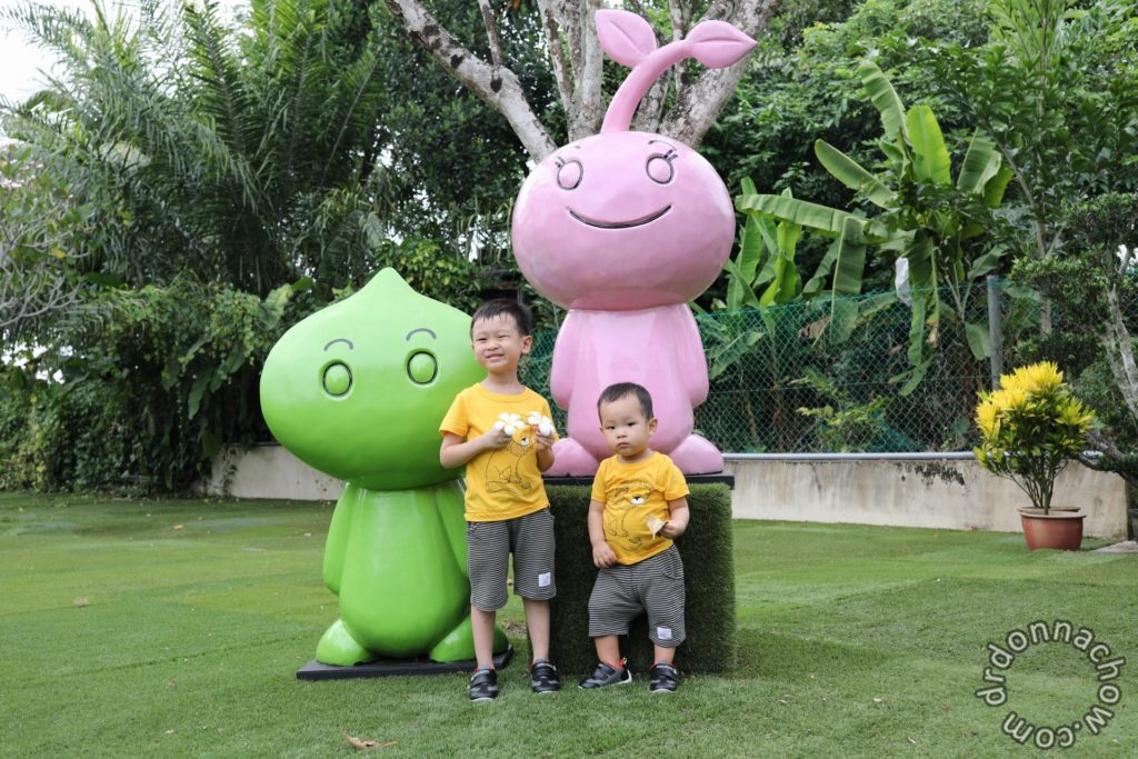 In front of the mascots of Gardenasia - Titoy and Morchoo